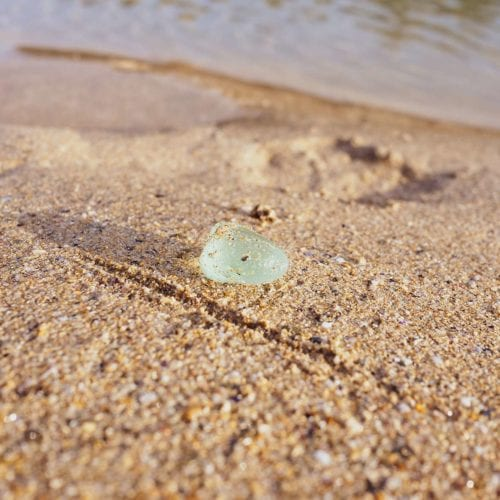 picking-up-sea-glass-found-on-beach-2